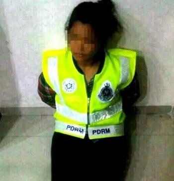 Polis wanita palsu ditahan.